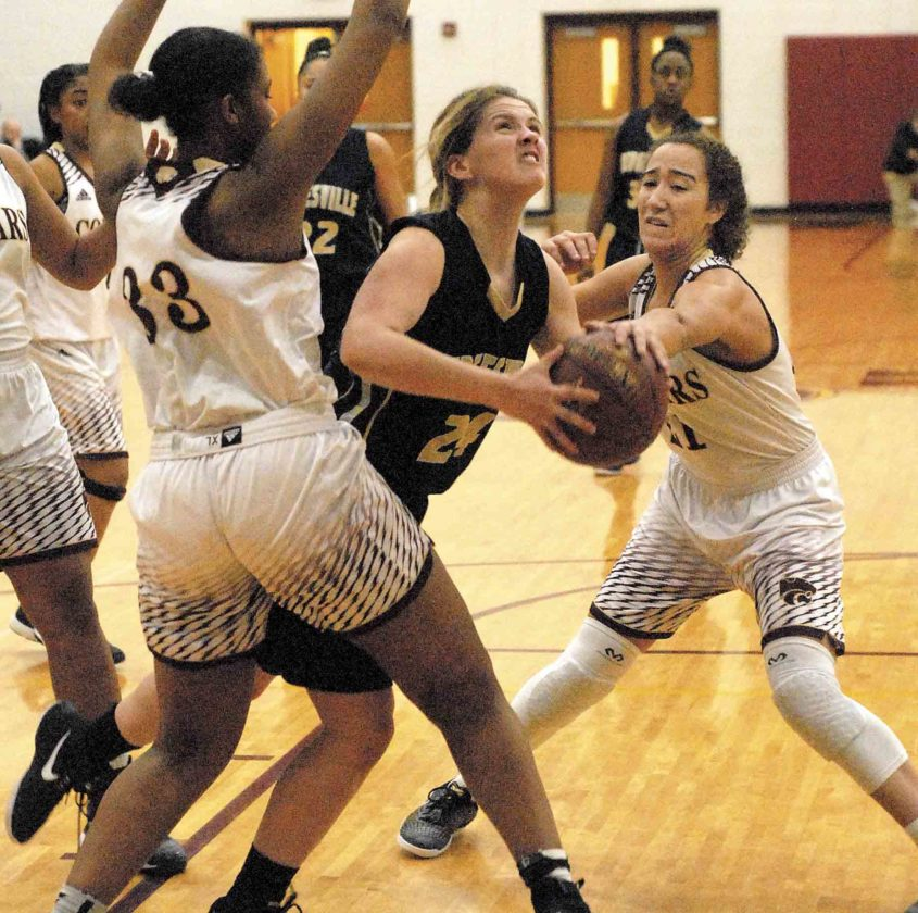 Jefferson's Christiana Armstrong (33) and Kiayha Bradley double team Hedgesville 's Serenity McDill Tuesday night in Shenandoah Junction. See more photos on CU.journal-news.net. (Journal photo by Eric Jones)