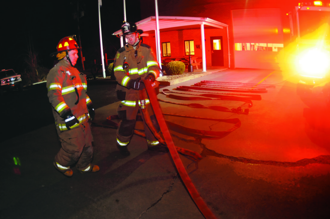 Journal photos by Ron Agnir From left: Junior firefighter Matthew Locke, 18, learns from Firefighter John Stammer how to pull and work hose lines during a training exercise Thursday in Shepherdstown.