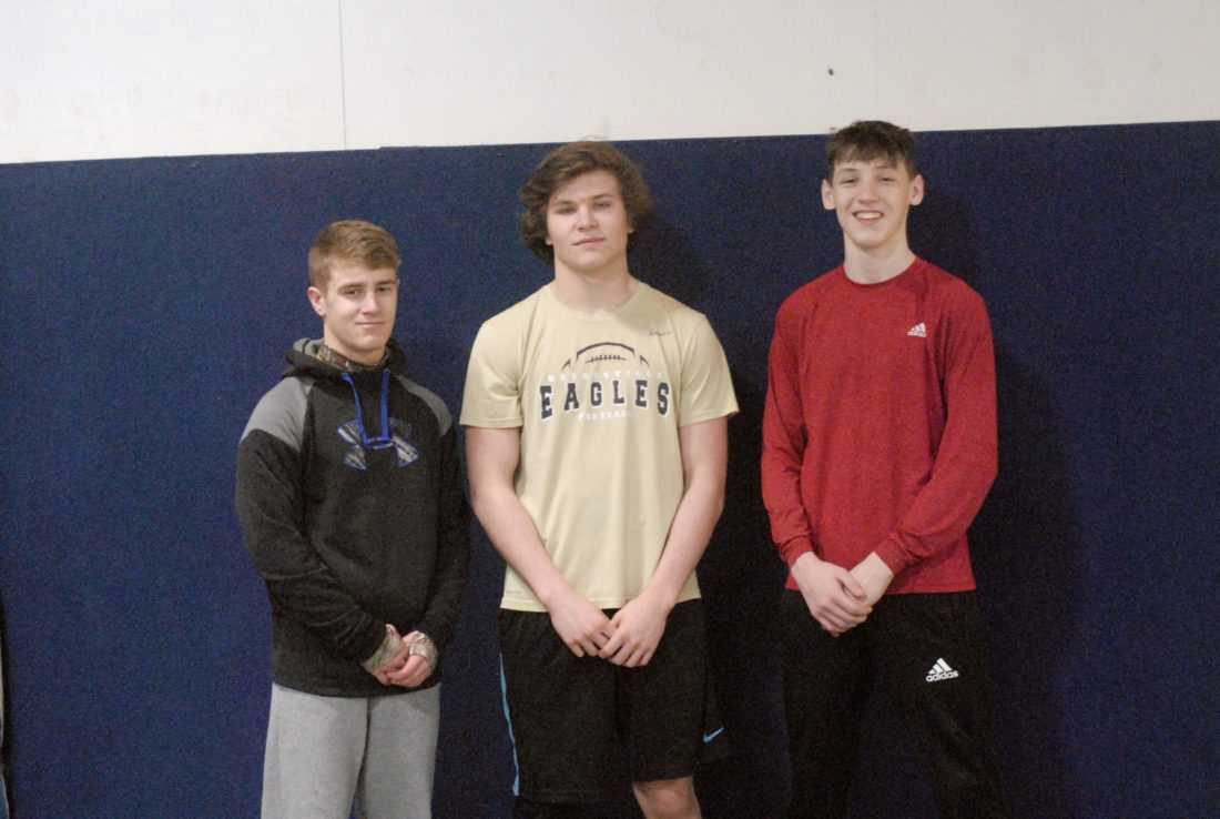 Pictured above from left to right is Hedgesville's Josh Hylton, Czar Parrish and Noah Wahler. All three wrestlers reached the 100-win milestone this season.