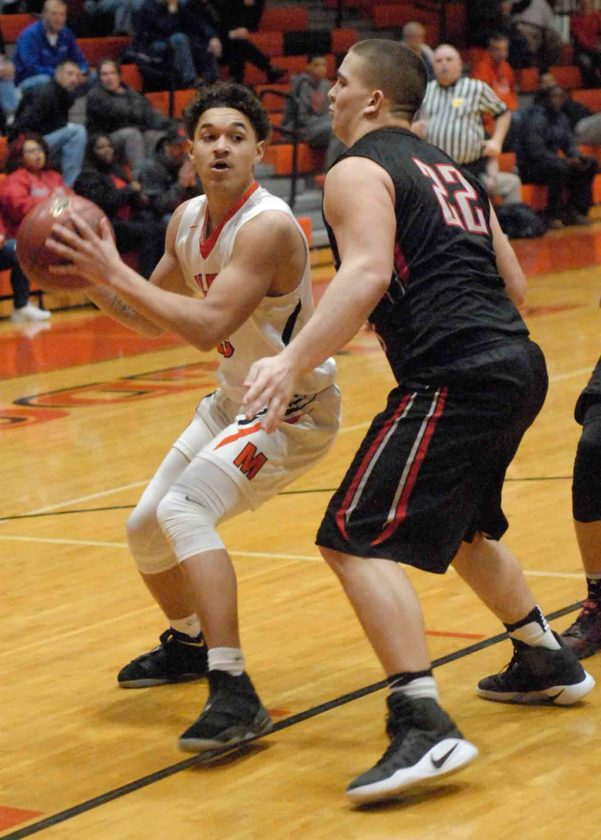 Journal photo by Eric Jones Martinsburg's Teddy Marshall, left, is guarded by Spring Mills' Mason Caldwell during the first half of their game on Tuesday in Martinsburg.