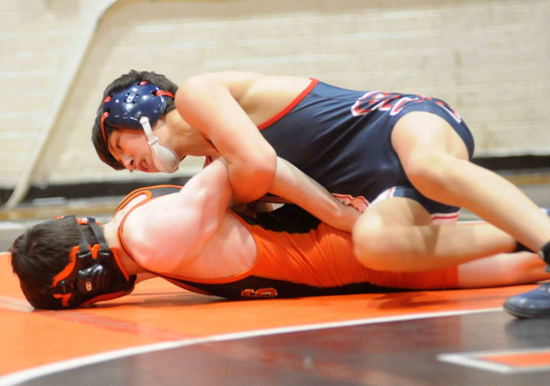 Michael Dolan of Spring Mills, top, has control of Martinsburg's Jeffrey Bosley in a match at 106 pounds. Dolan won by pin. (Journal photo by Ron Agni)