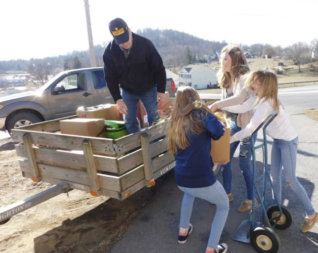 """Students from Hedgesville Middle School collect donations for the """"Loaves and Fishes"""" pantry. Over 3,000 cans were collected, and will be used to provide for the needs of those in the Hedgesville area. (Submitted photo)"""