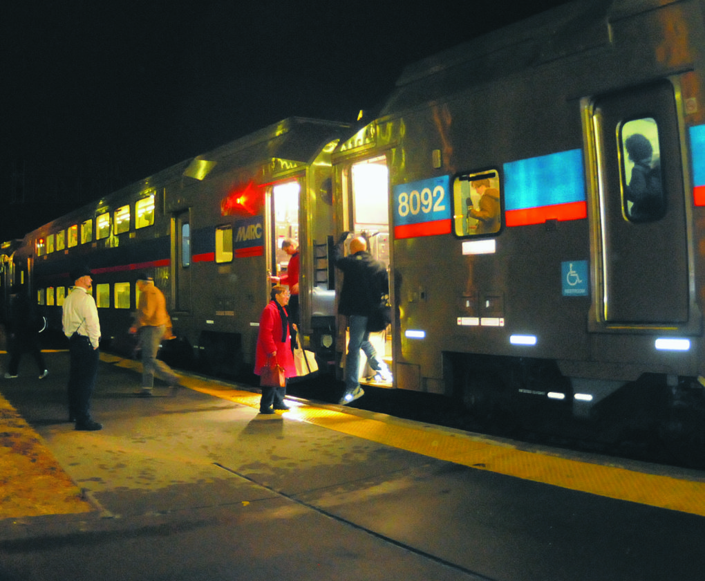 02 MARC1 ra 02-01-18 Commuters get off the  #873 MARC Train at Martinsburg Wednesday evening. (Journal Photo by Ron Agnir)