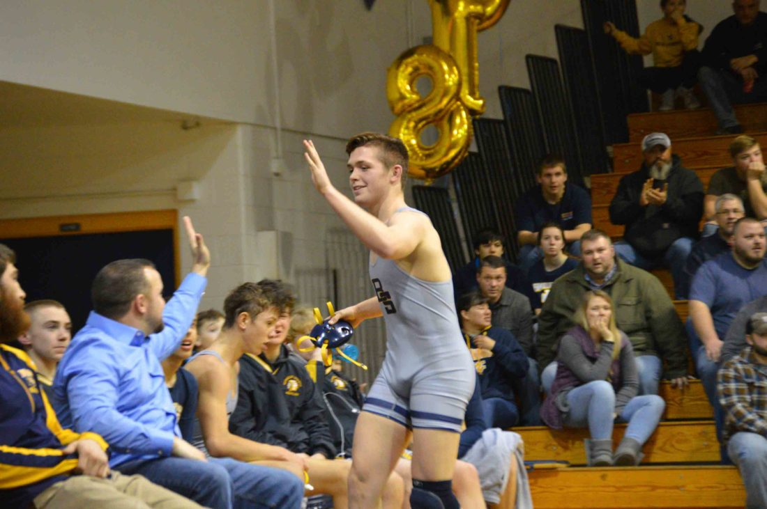 Davy Mundey celebrates on Thursday as the Berkeley Springs wrestler set the state's all-time victory mark with his 218th win. (Journal photo by Jessica Manuel-Wilt)