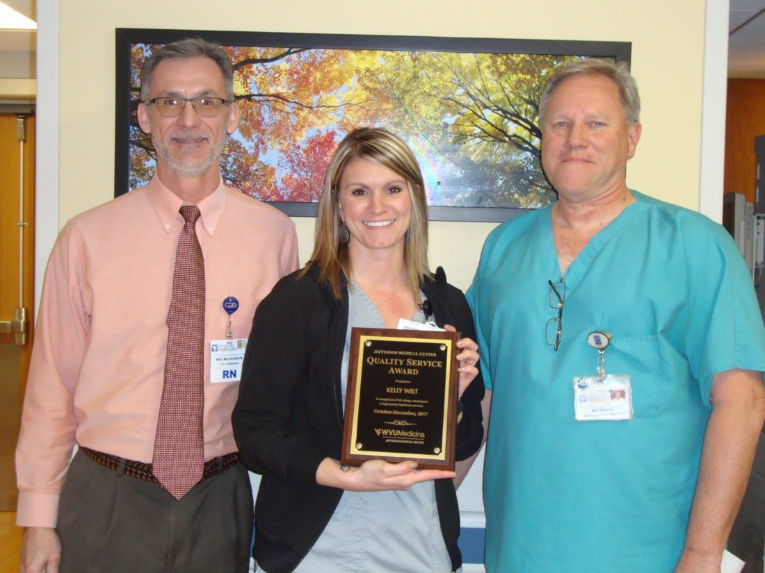Submitted photo Vice President Chief Operating Officer Neil McLaughlin (left) and Radiology Director Dan Sytsma (right) are pictured with Kelly Wilt, WVU Medicine Jefferson Medical Center's Quality Service Award winner for the fourth quarter 2017.