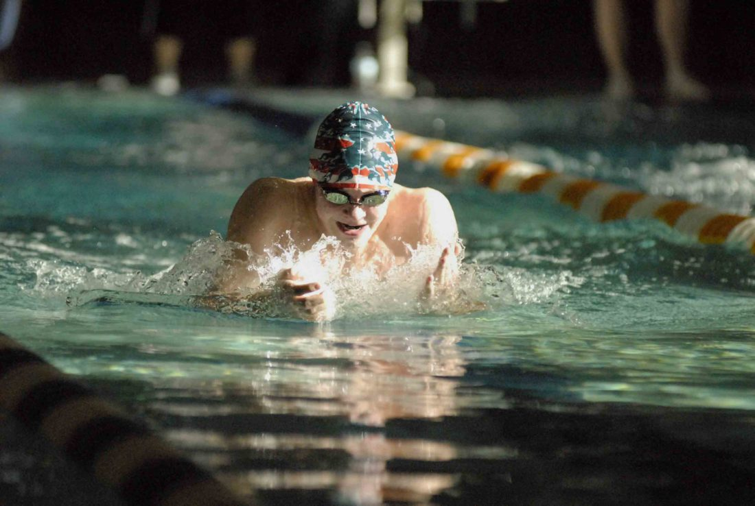 Washington's Eric McClaflin swims to a win in the 100-yard breaststroke during Saturday's Class AAA, Region II championship, helping the Patriots capture their second straight regional title (Journal photo by Eric Jones)