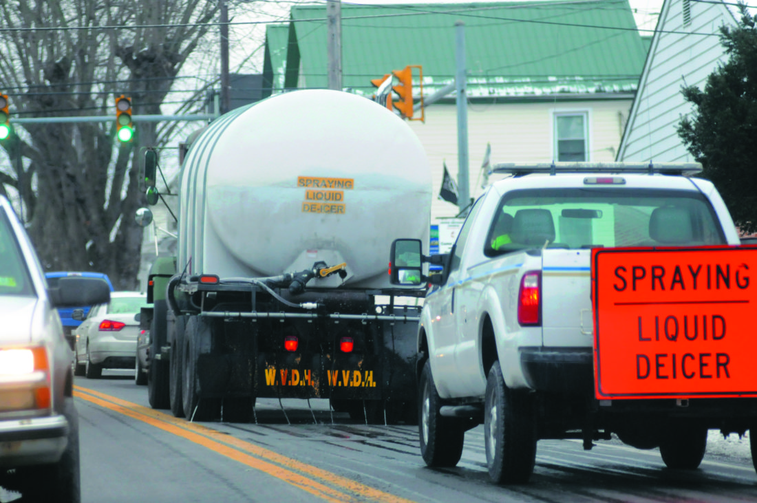 07 WVDOT-De-Ice2 ra 02-06-18 A WV-DOT Tanker Truck sprays  liquid de-icer solution along Rt.9 in Hedgesville to pre-treat the roads ahead of the upcoming snow and ice storm Tuesday afternoon. (Journal Photo by Ron Agnir)