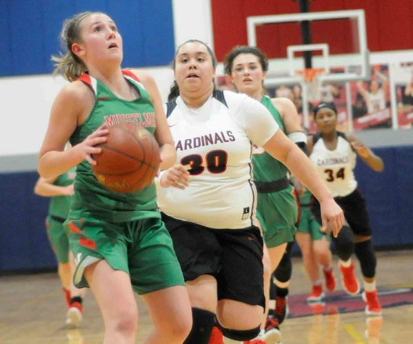 Journal photo by Ron Agnir Musselman's Allison Burdette, left, drives to the basket as Spring Mills' Cassie Kimble (30) pursues during the third quarter of Tuesday's game. See more photos on CU.journal-news.net.  (Journal photo by Ron Agnir)