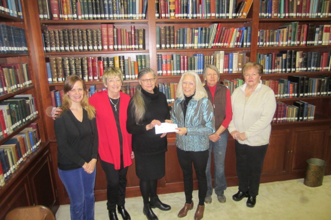 From left are Jean Petti, the garden club's vice president; Mancy McGlothlin, the club's Christmas Market coordinator; Marcella Genz, the library's director; Robin Huyett Thomas, the club's president; and club members Melissa Manning and Wilma Nemec during a donation presentation.   (Submitted photo)