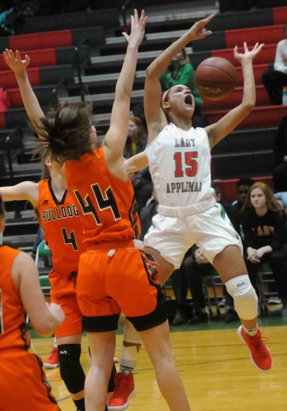 Martinsburg's Alisha Joseph (4) and Morganne Andrews (44) force Musselman's Janaia Fargo to lose control of the ball on a drive during first-quarter action Thursday evening in Inwood. See more photos on CU.journal-news.net. (Journal photo by Ron Agnir)