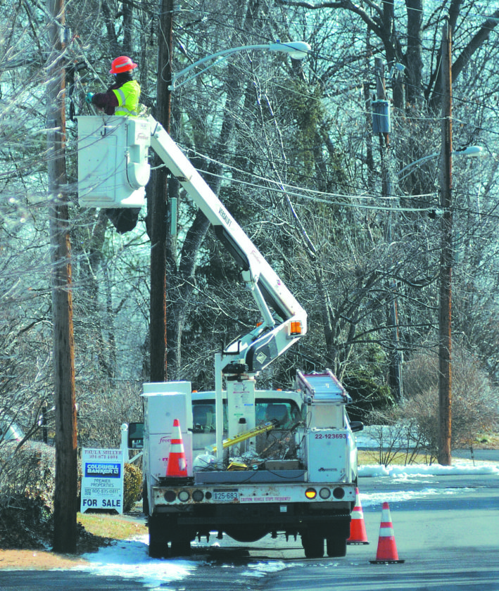 A Frontier.net service crew works on restoring service along North Street Wednesday morning  in Martinsburg. (Journal Photo by Ron Agnir)