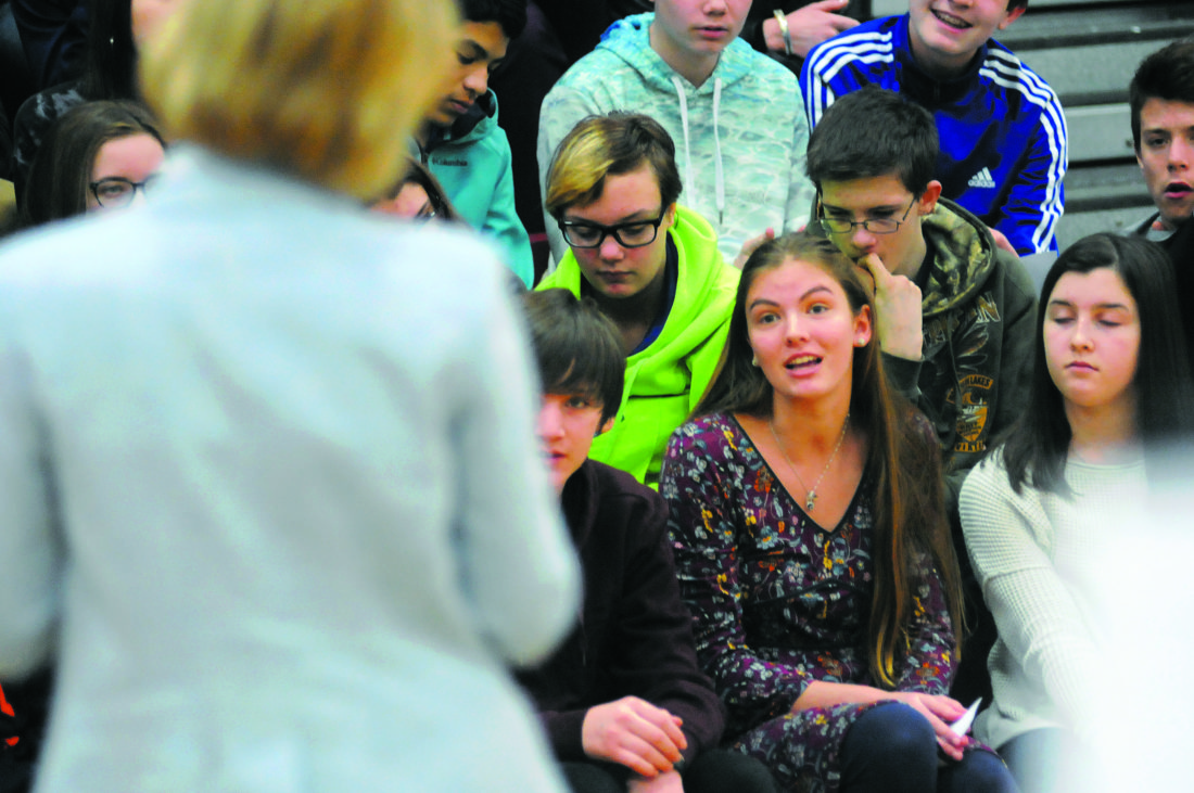 """Sen. Shelley Moore Capito listens as Wildwood Middle School 8th Grader Mollie Hanscom (purple dress) ask, """" When did you decide to get into politics?"""" in Shenandoah Junction Monday morning. (Journal Photo by Ron Agnir)"""