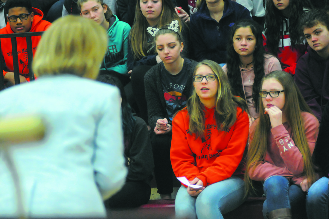 """Sen. Shelley Moore Capito listens as Wildwood Middle School 8th Grader Ella Warren (orange hoodie) ask, """" What is your view of the current educational system?"""" in Shenandoah Junction Monday morning. (Journal Photo by Ron Agnir)"""