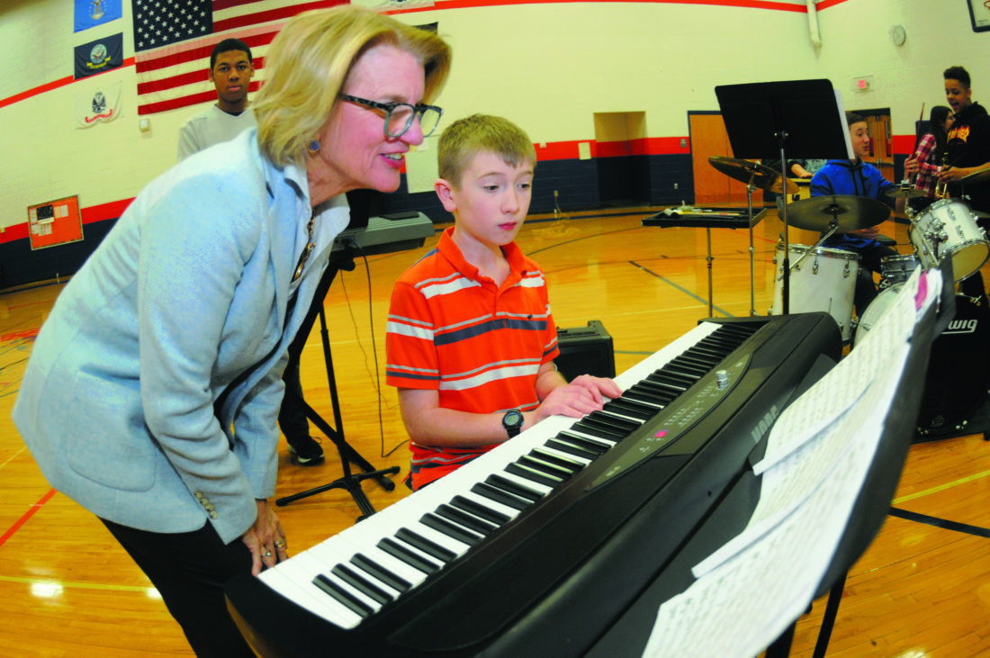 Sen. Shelley Moore Capito watches Erik Parker, 6th grader keyboardist with  Wildwood Middle School Mustang Band in Shenandoah Junction Monday morning. (Journal Photo by Ron Agnir)