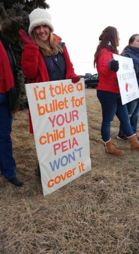Submitted photo Teachers protest pay and insurance issues outside Hedgesville High School Friday, Feb. 10.