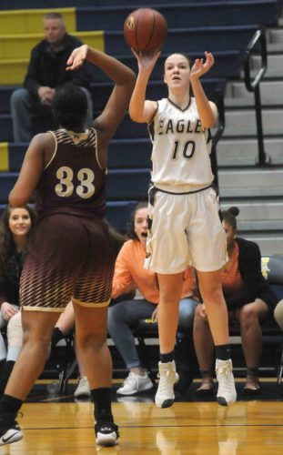 Hedgesville's Emily Bethel, right, shoots as Jefferson's Christiana Armstrong tries to defend during the game Wednesday in Hedgesville. (Journal photo by Jessica Manuel-Wilt)