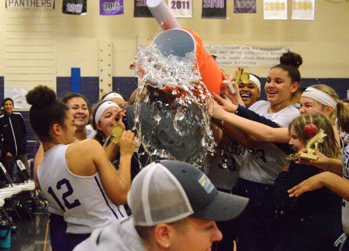 Charles Town coach Rahsaan Edwards gets doused by his eighth-grade team as they celebrate the Mountaineer Athletic Conference championship they won over Spring Mills on Thursday. (Journal photo by Jessica Manuel-Wilt)