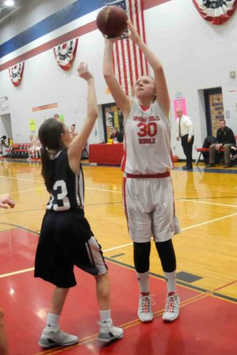 Addie Aversa puts up a shot for the Spring Mills seventh-grade girls team over Hedgesville's Hallie Myer during the Mountaineer Athletic Conference championship game on Thursday. (Journal photo by Ron Agnir)