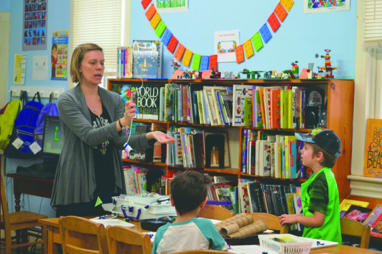 Journal photos by Adranisha Stephens   Shepherdstown Library Associate Director Christy Hagerty, above, works with homeschooled students in area.