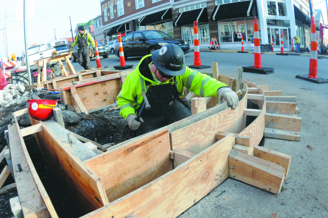 Cody Davis, of Triton  Construction, builds new sidewalk corners with handiacap accessible ramps  at N. George and West Liberty Street in Charles Town. (Journal Photo by Ron Agnir)