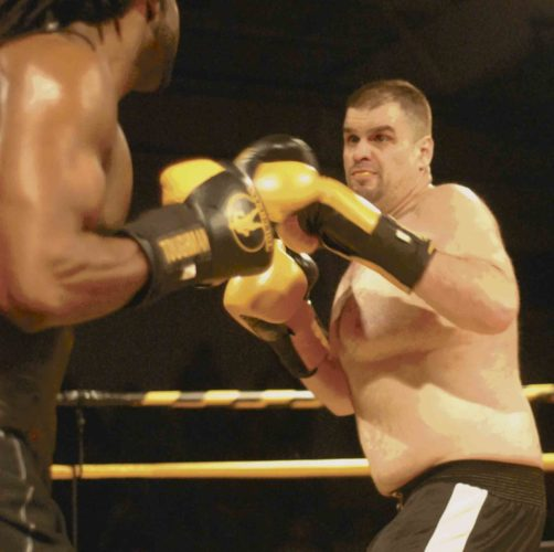 Journal photo by Rick Kozlowski Luc Poulin, right, fights with Chris McKenzie during the heavyweight championship bout in Saturday's Toughman Contest at the Berkeley 2000 Recreation Center.