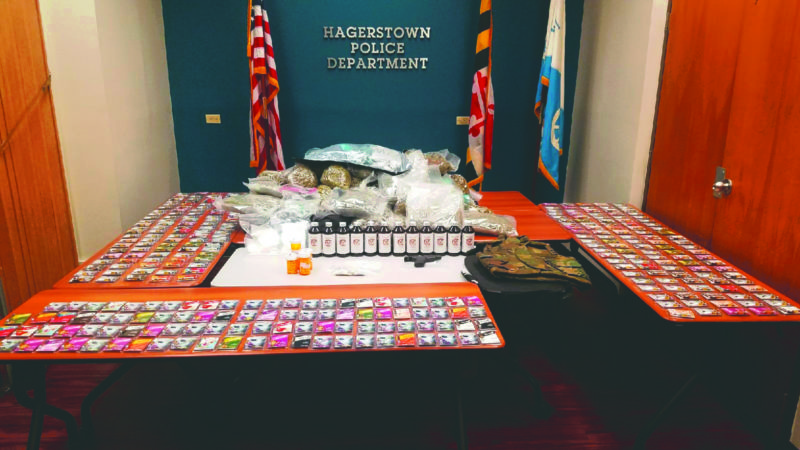 Submitted photo Pictured are the drugs, guns and ballistic vests sezied from the Hagerstown, Maryland residence.