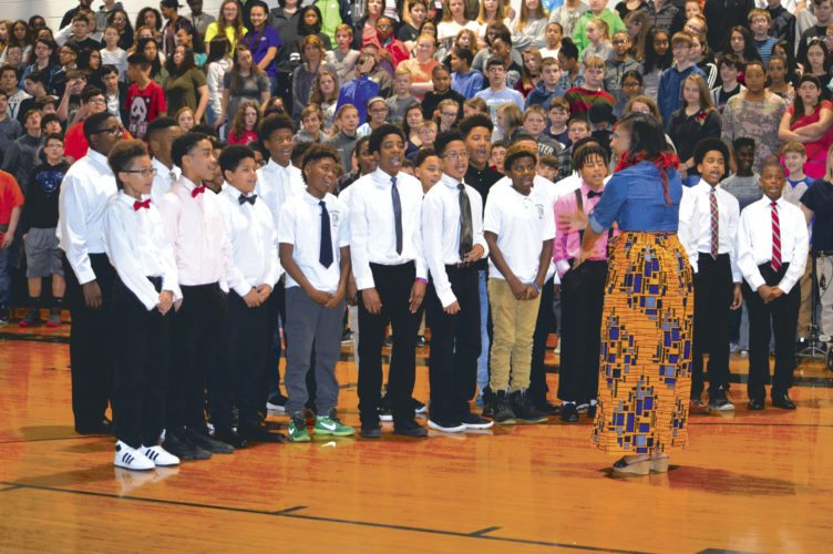 "Tanya Dallas Lewis, teacher at South Middle, conducts the All Boys Choir in a rendition of ""Lift Every Voice and Sing"" at the third annual Black History Month celebration. (Journal photo by Adranisha Stephens)"