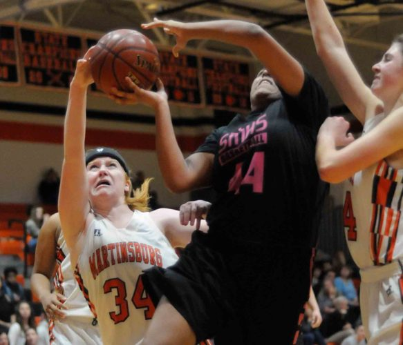 Martinsburg's Amelia Jenkins, left, slips in and blocks the shot attempt by Spring Mills' Jada Brooks as Morganne Andrews helps defend during the second half of the Class AAA, Region II, Section 1 championship game. See more photos on CU.journal-news.net.  (Journal photo by Ron Agnir)