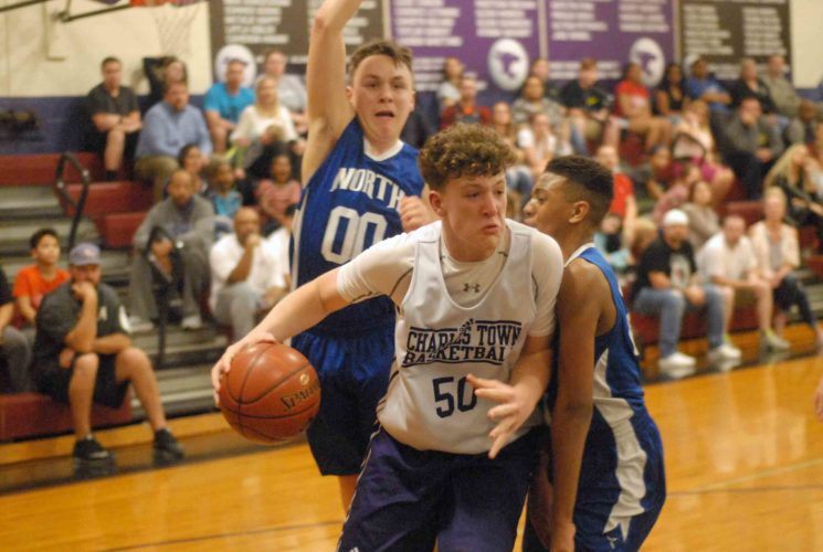 Blaise Grove of Charles Town drives past North's Adam Walls, back, and Kosi Jackson. (Journal photo by Rick Kozlowski)