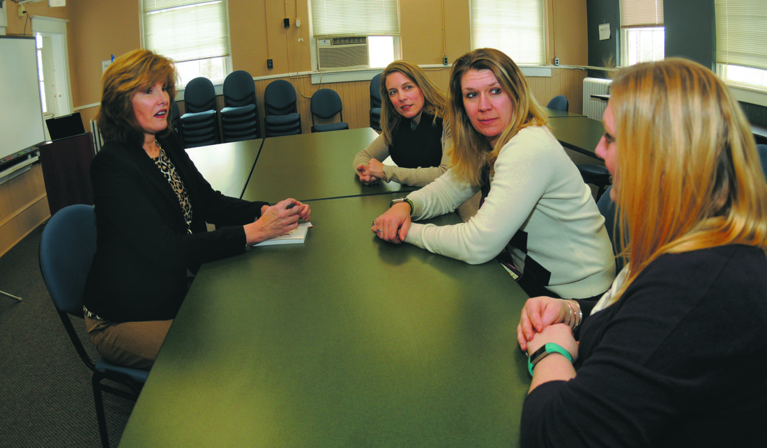 From left: Joni Greenberg, coordinator, Project Aware trainer/evaluator, meets with Tricia Ballard, Kija Wilson and Stephanie Harding Friday afternoon at the Ramer Center in Martinsburg. (Journal photo by Ron Agnir)