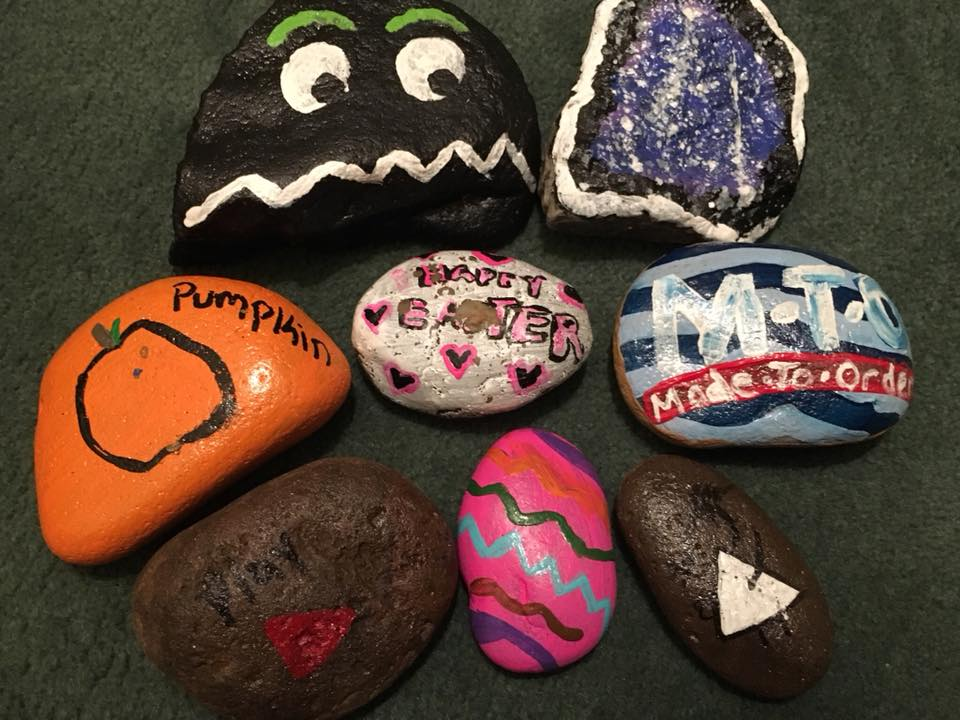 painted rocks designed to help bring smiles to community news
