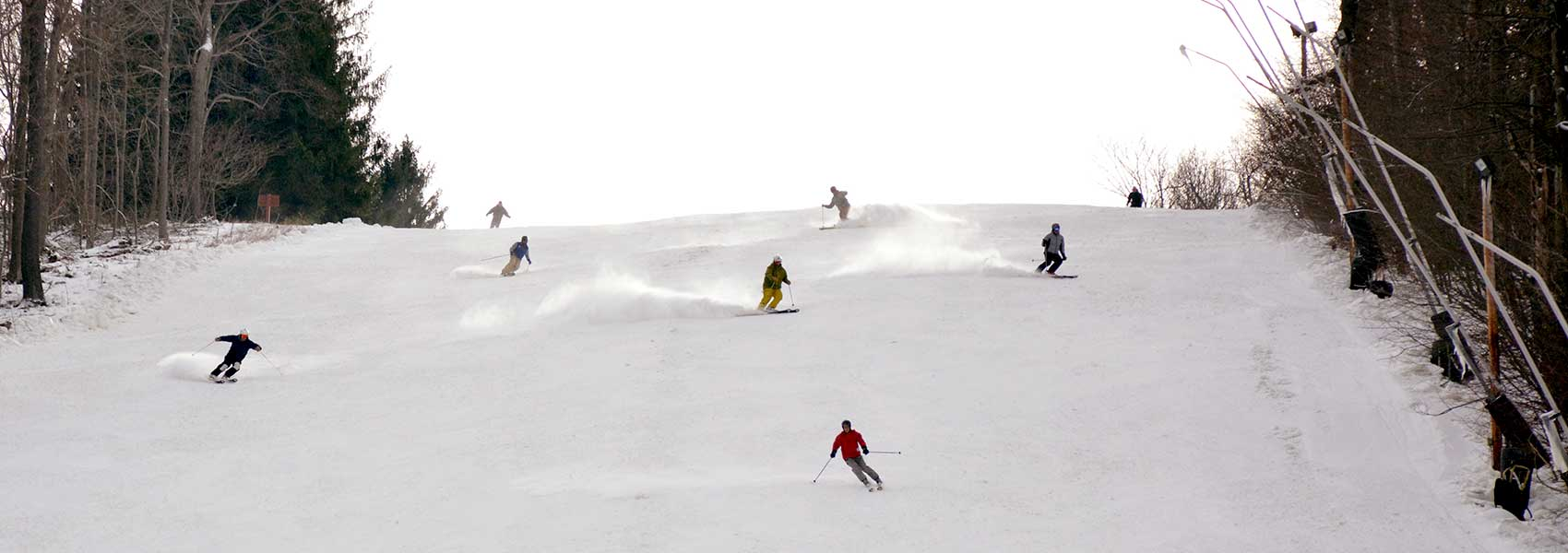 Skiers coming down the slope