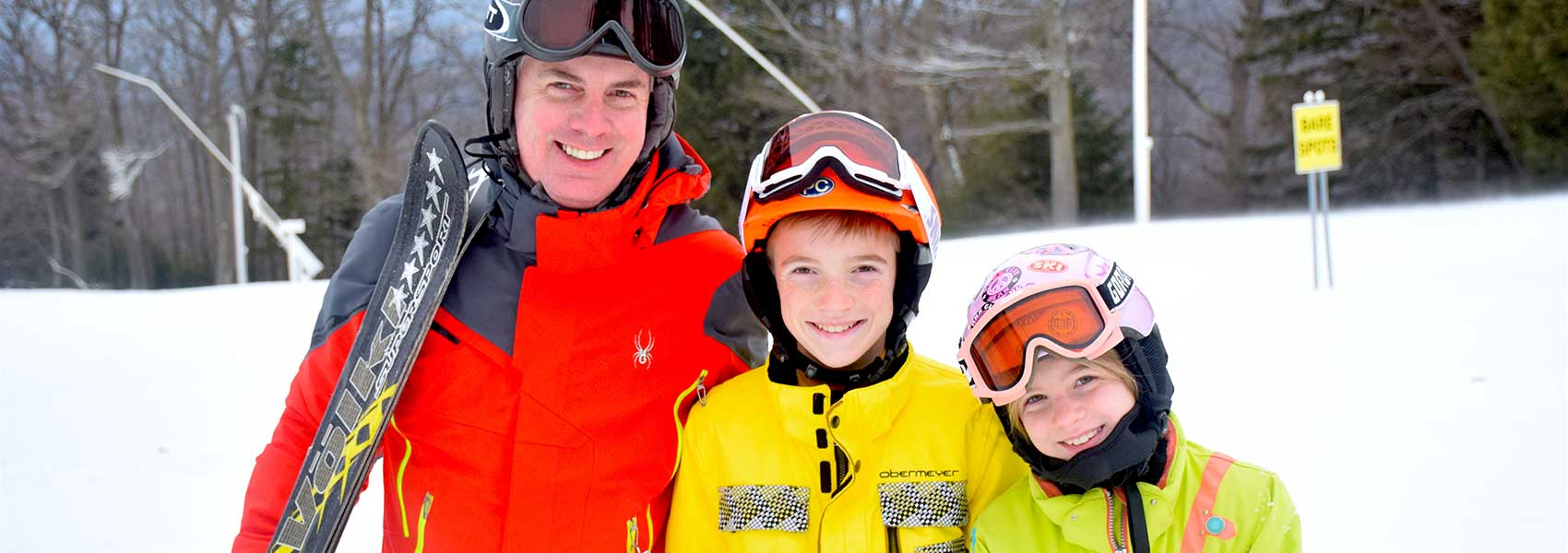 dad-and-kids-ready-to-go-skiing