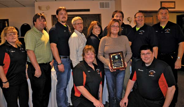 Michelle Homkey, widow of Jamie Homkey, holds the First Responder of the Year award, surrounded by the Canajoharie Fire Department. (The Leader-Herald/Opal Jessica Bogdan)