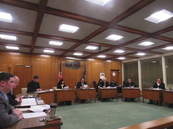The 2017 legislature board sits together as they discuss their first resolutions for the county of the year. (The Leader-Herald/Opal Jessica Bogdan)