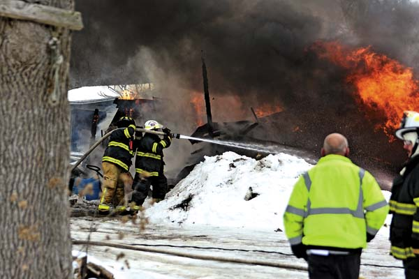 Firefighters battle a storage-garage  fire in the town of Johnstown on Tuesday.  (The Leader-Herald/Bill Trojan)
