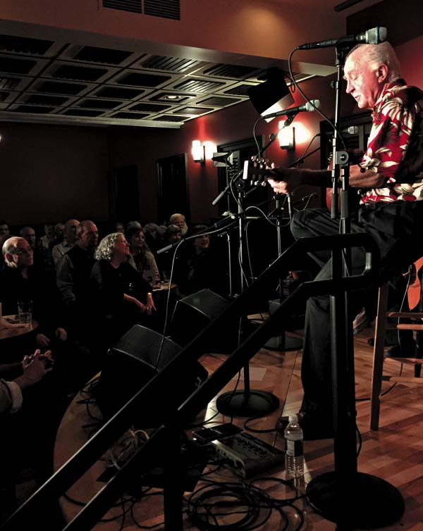 In this Jan. 7 photo provided by Sarah Craig, folk singer Steve Gillette performs at the newly renovated Caffe Lena, where Gillette has appeared since the 1960 Bob Dylan also performed at Caffe Lena during the 60s and would surely still recognize the low-ceilinged room, but just about everything else about a venue that bills itself as the nation's oldest continuously operating coffeehouse.  (Sarah Craig via AP)
