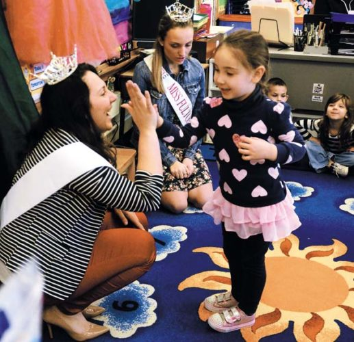 2017 Miss Fulton County Heather Graves, left, gives pre-kindergartener Briella Lucas a high five during her first public appearance while at Park Terrace Elementary School in Gloversville on Jan. 27. 2016 Fulton County Miss Outanding Teen Alexis Houser is seen in the bacground on her last full day as Fulton County Miss Outstanding Teen. (The Leader-Herald/Bill Trojan)
