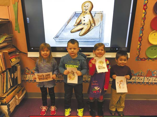 """After listening to """"The Gingerbread Man,"""" Herkimer-Fulton-Hamilton-Otsego BOCES pre-kindergarten students Kara Rutherford, Paxson Dommer, Adrianna Santucci and Caleb Coffin, at West Canada Valley, retold the story and then decorated and ate their own gingerbread-man cookies.  (Photo submitted)"""