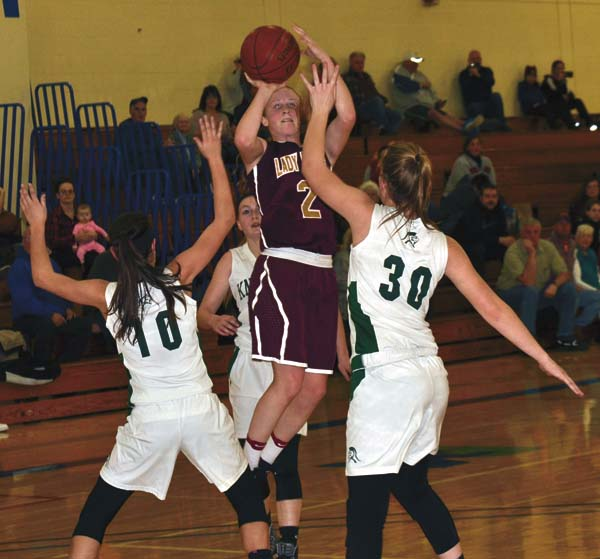 Fonda-Fultonville's Julianna Taylor (2) shoots over Middleburgh's Lyndsey McCoy (10) and Kelsey Campbell (30) during Tuesday's Western Athletic Conference crossover game at Fulton-Montgomery Community College. (The Leader-Herald/Paul Wager)