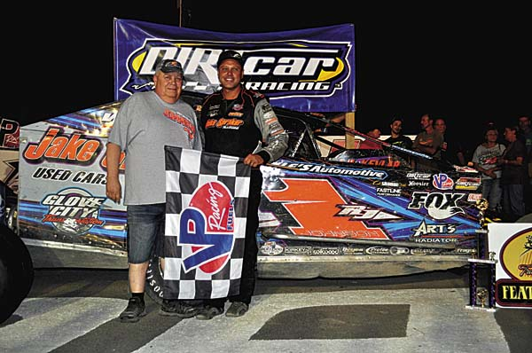 Jake Spraker, left, poses in Victory Lane at Fonda Speedway with Ronnie Johnson after Johnson won the 2016 modified track championship on Aug. 20. (The Leader-Herald/James A. Ellis)