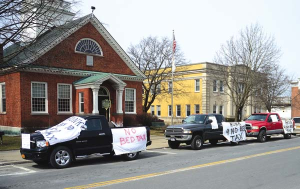"Protestors draped their vehicles in ""No Bed Tax"" signs along North William Street in Johnstown on Monday. The ""bed tax"" passed anyway. (The Leader-Herald/Bill Trojan)"