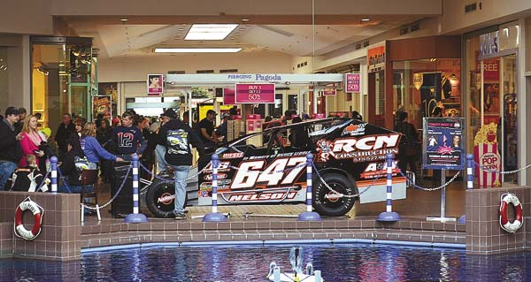 Race fans file past Brian Nelson's modified Saturday at the annual Northeast Auto Racing Expo at the Via Port Rotterdam Mall. The show concludes today at the mall from 11 a.m. to 6 p.m. (The Leader-Herald/James A. Ellis)