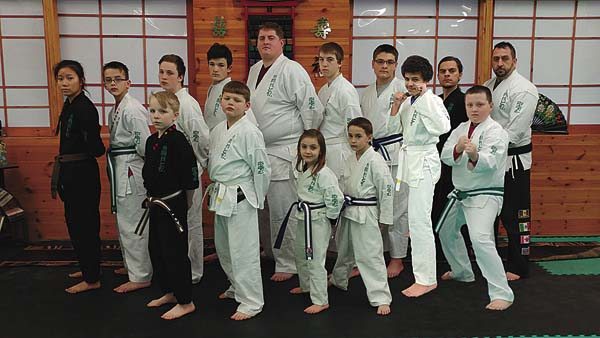 Several members of Pazzaglia's Kenpo Karate in Johnstown recently earned rank promotions. In the back row, from left, are Tia Thompson (first Kyu brown), Robert Carpenter (junior green, Tristan McMillion (junior orange), Ryan Frye (purple), Jason Michael Sr. (eighth Kyu white), Tyler Savage (eighth Kyu white), Colemar Henderson (green), Darnell VanSlyke (eighth Kyu white), Matt Van Nostrand (first Kyu brown) and chief instructor Joe Pazzaglia. In the front row, from left, are Bobby Morse Jr. (first Kyu brown), Jason Michael Jr. (eighth Kyu white), Mia Pazzaglia Jr. Purple, Xzavier Cool (junior purple) and Tyler Sprague (junior green). Not pictured is David Hopkins (purple). (Photo submitted)
