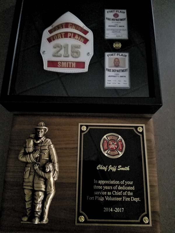 A plaque showing honors given to Jeff Smith by members of the Fort Plain Volunteer Fire Department. (The Leader-Herald/Jason Subik)