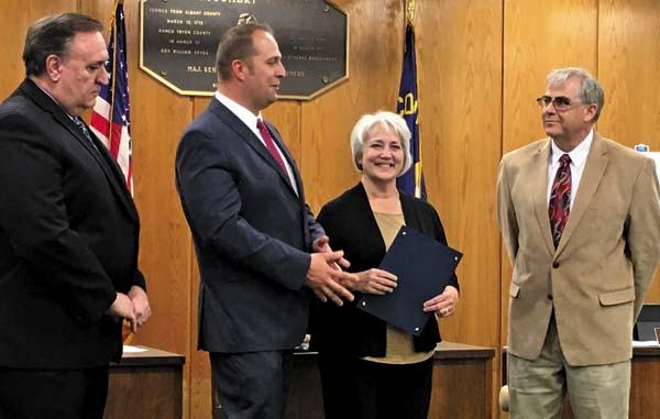 """From left, Legislative Chairman Roy Dimond, County Executive Matt Ossenfort, Stephaine Boice and District 9 Legislator Robert Purtell. Boice, who is Ossenfort's mother, was honored Tuesday for her impact on students during her 33-year career as a music teacher, as well as her contributions during her retirement. Tuesday was officially named """"Stephanie Boice Day."""" (The Leader-Herald/Jason Subik)"""