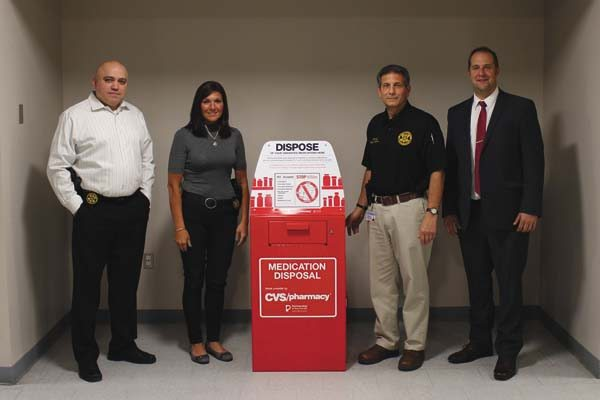 From left, Inv. Roberto Garcia, Inv. Karla Swartz, Sheriff Michael Amato and County Executive Matt Ossenfort pose with the new drug take back box stationed inside the Montgomery County Sheriff's Office.  (Photo submitted)