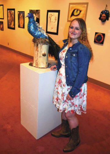 Sammantha Heyer with her award-winning mixed media sculpture Steve the           Peacock. (Photo submitted)