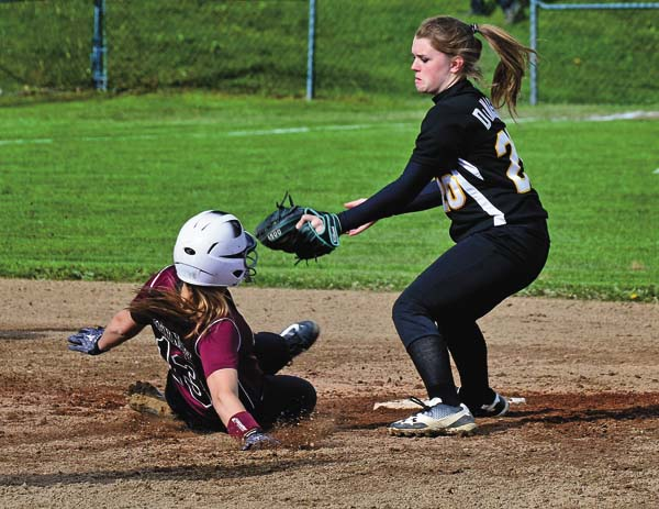 Canajoharie's Brianna DiMascio, right, looks to tag Fort Plain's Kendall Kennedy during Monday's Western Athletic Conference softball game. (The Leader-Herald/Bill Trojan)