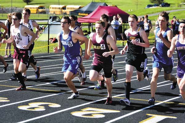 Runners leave the starting line to begin the boys steeplechase at the Western Athletic Conference Championships on Tuesday. (The Leader-Herald/Bill Trojan)